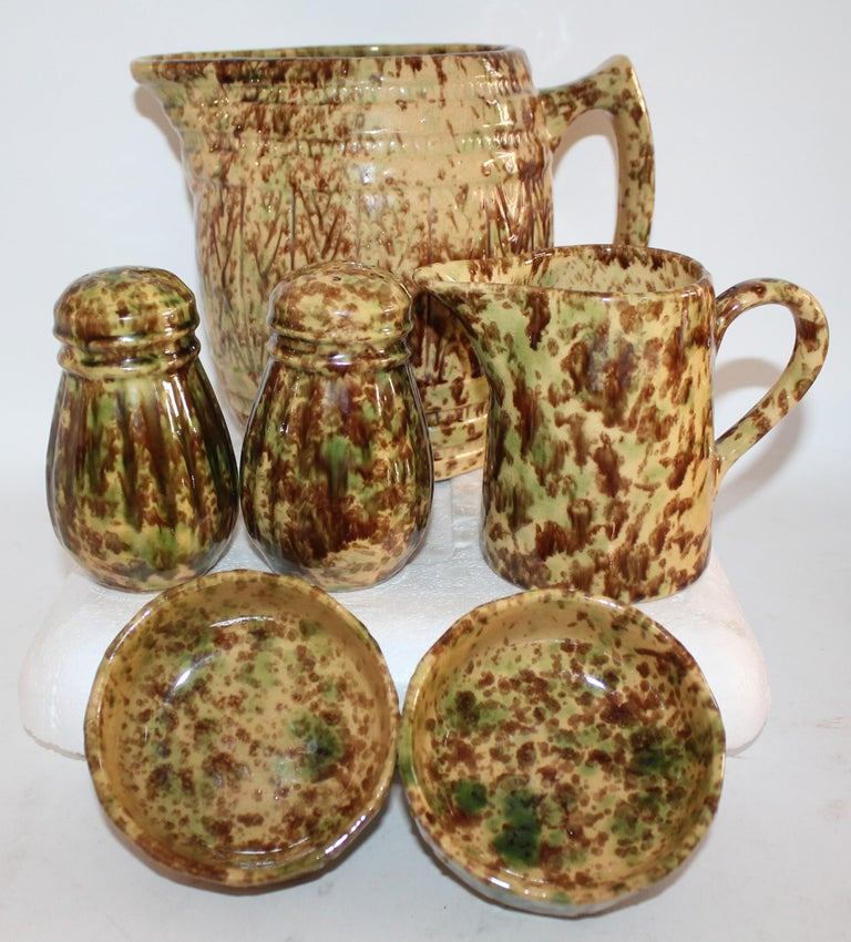 This collection of Bennington pottery is from New England and is all in very good condition. It is like a form of yellow ware with brown and green sponged glaze. This was made in Bennington, Vermont in the late 19th century. It is very rare to find