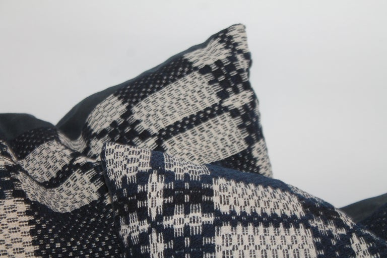 These fine handwoven coverlet pillows are in fine condition and have indigo blue linen backings. The inserts are down and feather fill.