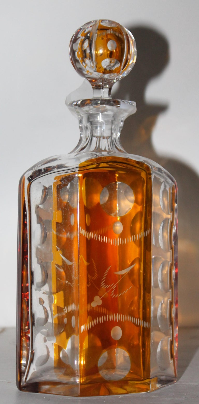 19th century Fantastic cut glass lead crystal with amber flash trim. This cut glass bourbon bottle is in fine condition.