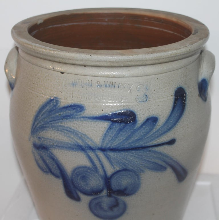 This three gallon stone ware crock with decorated cherries is from Harrisburg, Pennsylvania. The maker is Cowden & Wilcox and is signed on the front above the hand painted decoration. The crock is double handled and in mint condition.