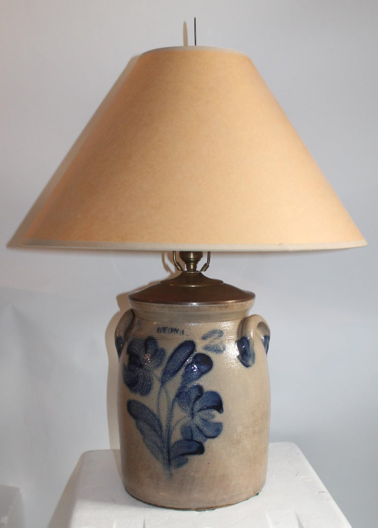 This 19th century blue salt glaze decorated flowers crock with double handles and signed