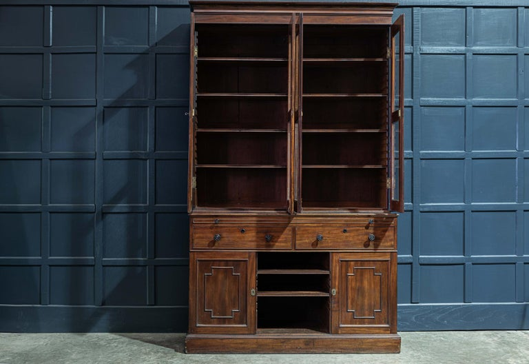 19th century English mahogany glazed secretaire bookcase circa 1870.  19th century mahogany glazed secretaire bookcase with 4 glazed cabinet doors above a pull out mid section leather writing slide. With 2 large dovetailed drawers, adjustable