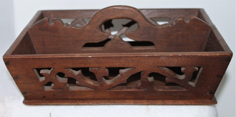 This fine walnut cutlery carrier has great cut outs and in very good condition. This New England carrier is very well made and fine details.