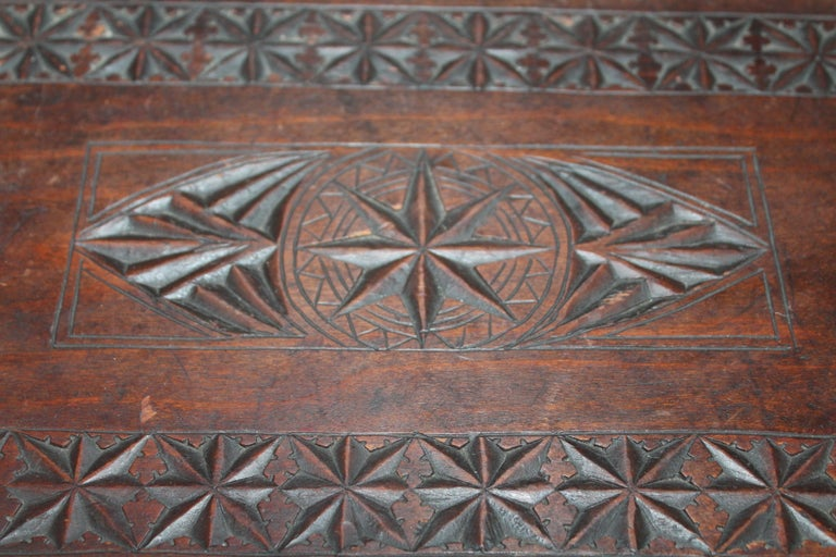 19th century hand carved nautical foot stool with cutout hearts on the sides. Detailed carving through out.