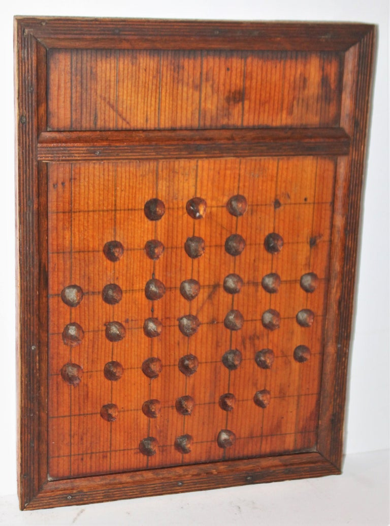 19th century handmade pine marble game board in good condition with a nice mellow patina.