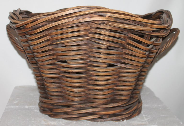 This fine handmade and woven basket is in great condition. The patina is really great.