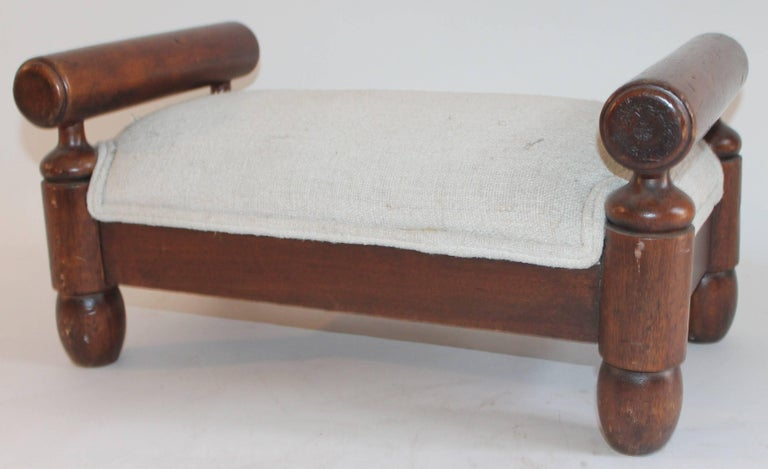 19th century handmade foot stool with homespun linen upholstery. This stool is in pristine condition.