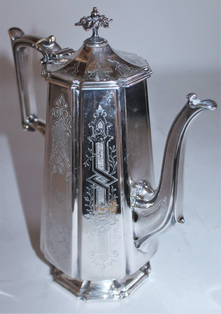 This fine handcrafted coffee pot is in fine condition with detailed hall marks on the bottom and fine lines. The condition is mint. Elkington & Co electroplate with Elkington's own date code for 1800s.  Letter