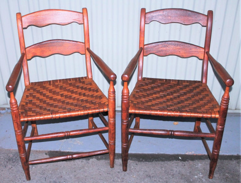 This fine pair of ladder back hickory chairs are in fine condition with a wonderful aged patina. They are in great condition and super comfortable. Sold as a perfect matched pair.