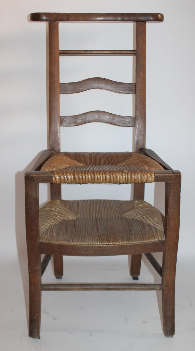 19th century lift top high chair for children with beautiful cane lift top seat.