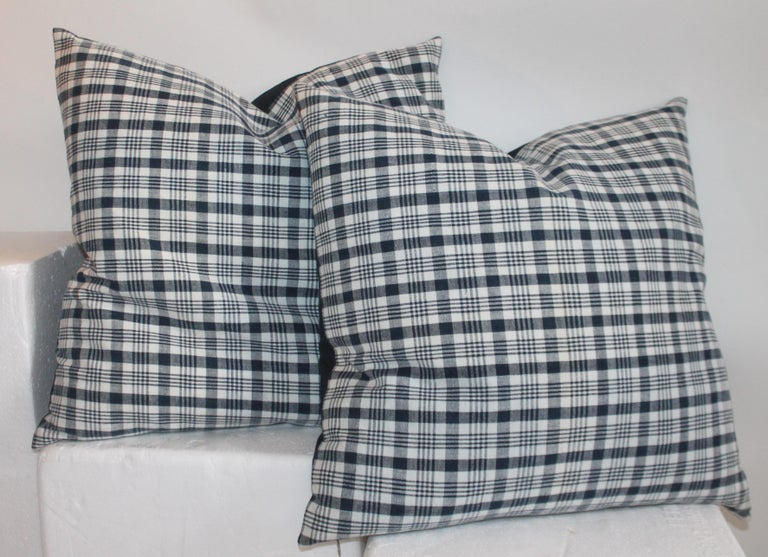 Pair of large pillows measure 22 x 22 19th century linen homespun indigo and white linen pillows. The backings are white cotton linen. The inserts are down and feather fill. Smaller pillows measure 20 x 20.