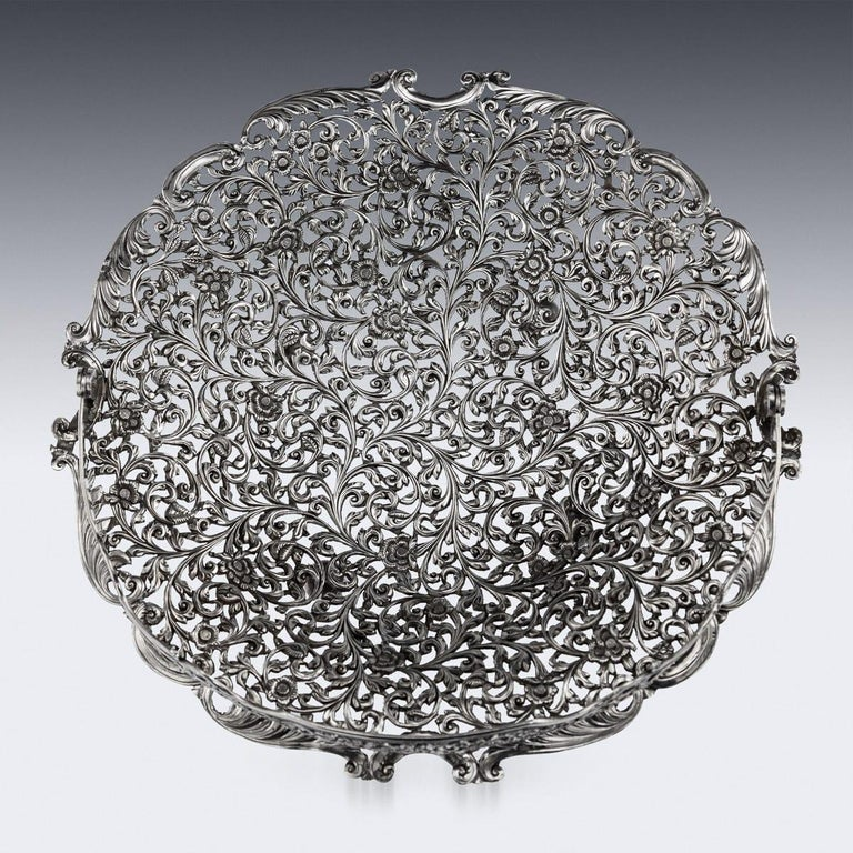 Antique 19th century Indian Kutch (Cutch), Bhuj, Gujarat region hand crafted and pierced solid silver basket, of shaped round form on four ball feet, finely chased and pierced with scrolling leaves and flower pattern in a finely tooled background,
