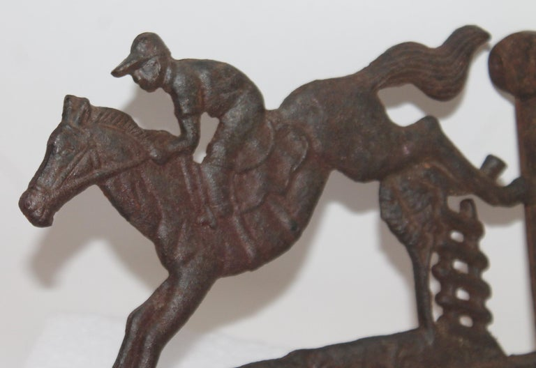 This folky wall mount of a horse and rider is in fine as found condition with a nice aged patina. This could be used as a basket holder or iron pit holder near a fire place.