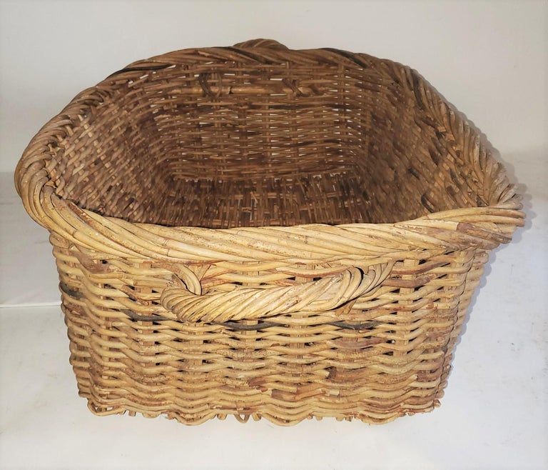 This fantastic double handled basket is in good condition and could handle a bunch of fruit or bagged bread. The condition is very good. A great display piece for a kitchen or retail store. In very nice condition.