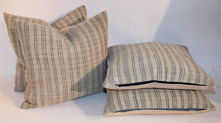 These homespun linen ticking pillows are in pristine condition and have natural linen backing. These natural linen with light blue stripes are very rich and yet country.