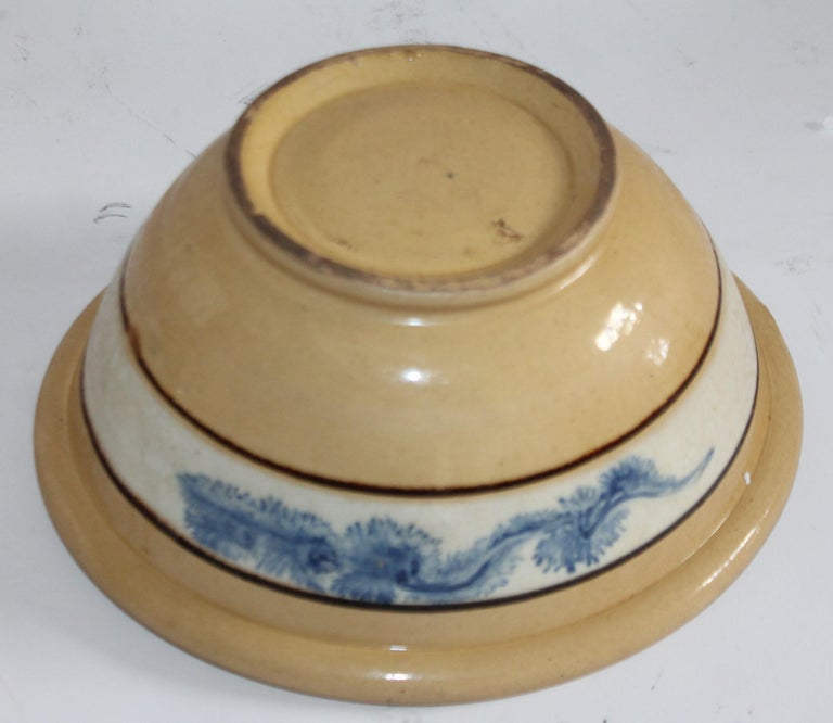 19th century yellow ware bowl with seaweed design pattern in band. The condition is very good and no cracks or chips.
