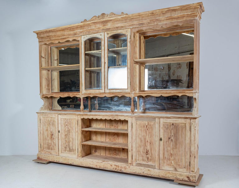 Circa 1890  19thC monumental French bleached mahogany and pine mirrored boulangerie shop cabinet  (Top cabinet finials are loose and slot into position, with or without)  An ideal Kitchen dresser or retail shop fitting.  Provenance: Prue