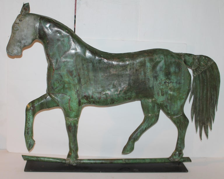 This early mid 19thc full body copper patinaed horse weather vane made by Harris & Co. and from a private folk art collection. The condition is very good with a few expected dings & dents and has an amazing patina. Looks like it has a dent in the