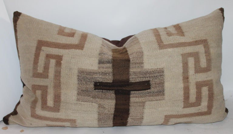 These two amazing and early Navajo Transitional Weaving pillows are in great condition with minor spotting or fade in areas. Sold as a group of two. One is a large cross and other is a geometric bolster. Both pillows were cut by the same