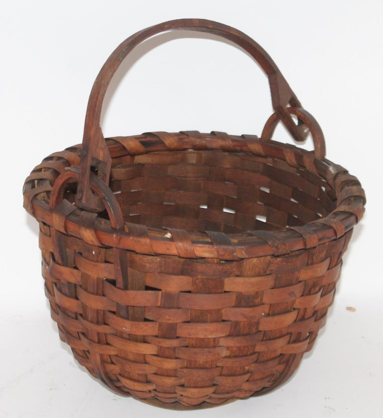 19th century early New England swing handled basket in amazing as found condition. This basket has a wonderful mello patina.