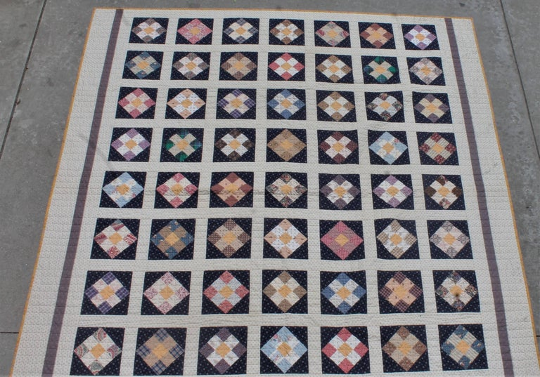 This fine early fabric example of a sampler nine patch quilt is in very good condition. It has hand pieced pieces and has treadle machine over throughout the quilt. This was done to keep the condition strong and great! These bars of nine patch's