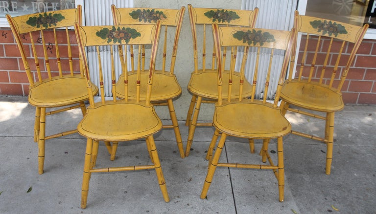 These fine original paint decorated thumb back New England Windsor chairs are in amazing sturdy condition. The painted decorated splash is amazing painted details. The seats may have been touched up by the previous collector. The condition of these