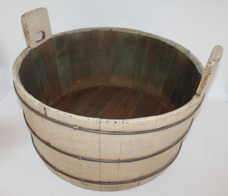 This Shaker style wash tub has double handles and is in sturdy tight condition. The patina is great and it has three original security bands great for fire wood storage next to fireplace.