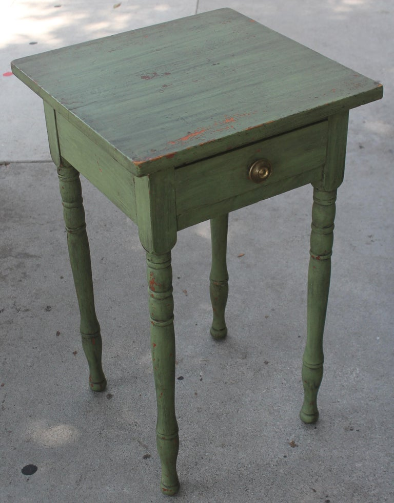 19thc original green painted one drawer stand in fantastic condition. This was found in a collection in Lancaster County, Pennsylvania. Amazing green over red painted surface.