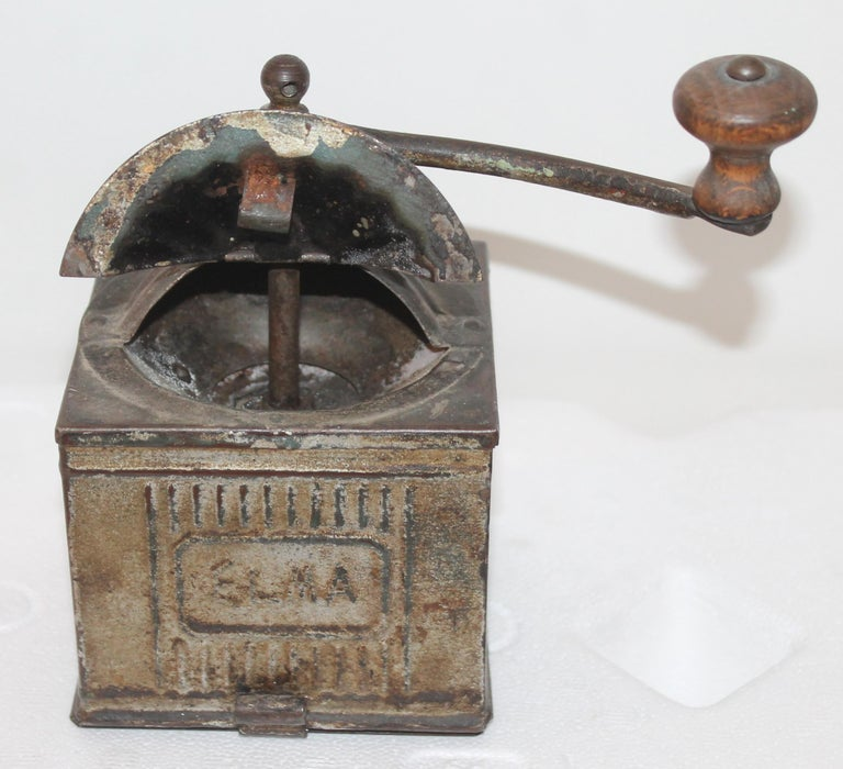 This silver-grey original painted tin coffee grinder in fantastic as found condition. This has the original crank.