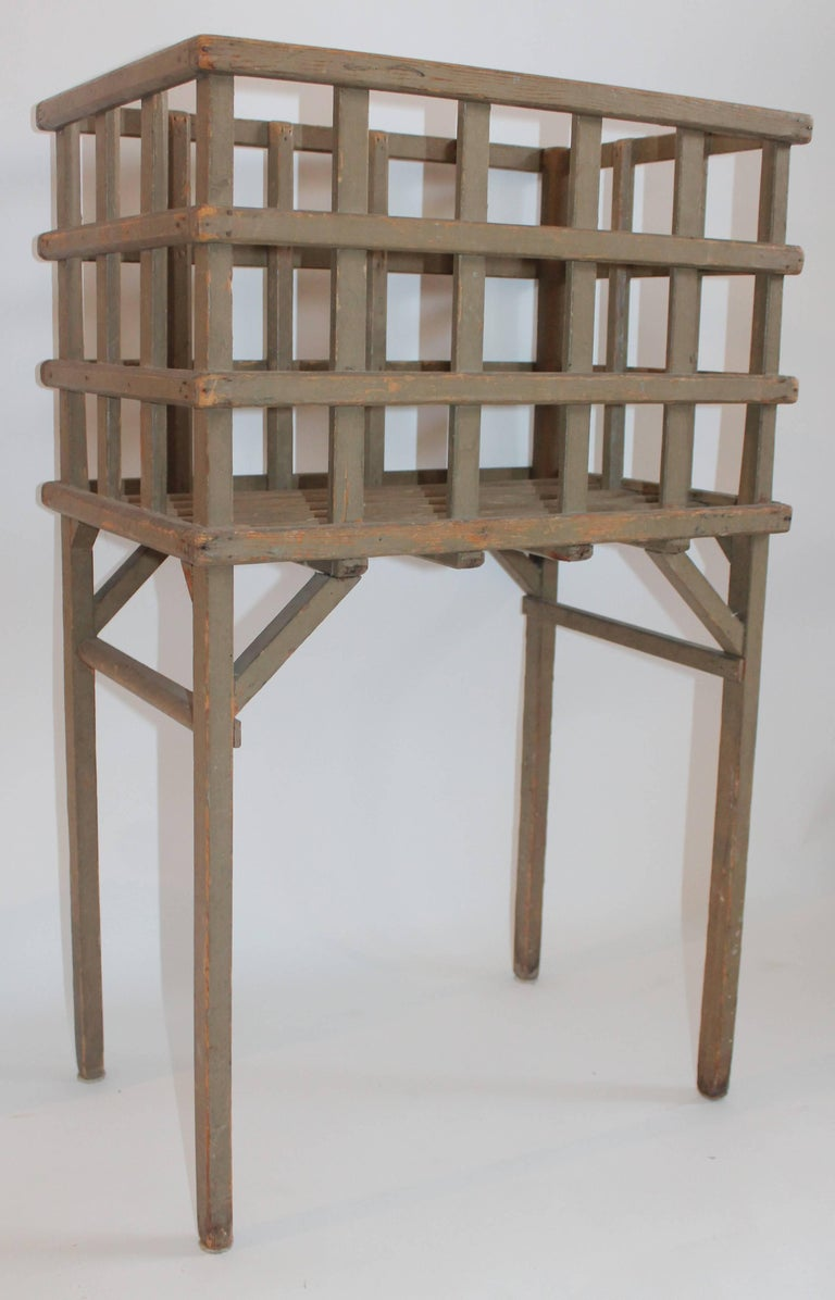 This cool sage green original lattice basket on legs is in fine condition, Great for textiles.