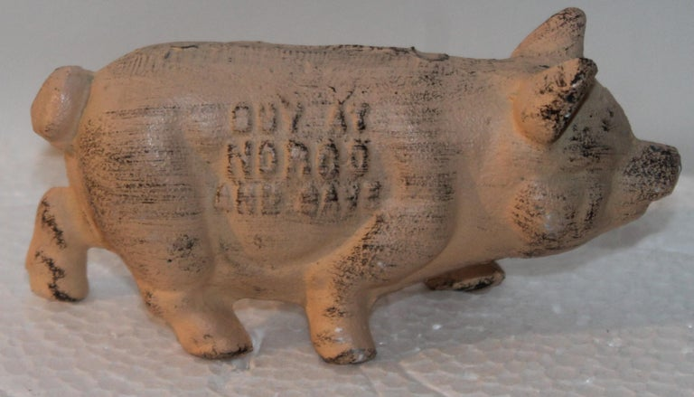 19Th century painted pink cast iron pig from Norco Foundry in Pottstown, Pennsylvania. It states: BUY AT NORCO FOUNDRY AT POTTSTOWN, PENNSYLVANIA. This is a very heavy paper weight or display ad.