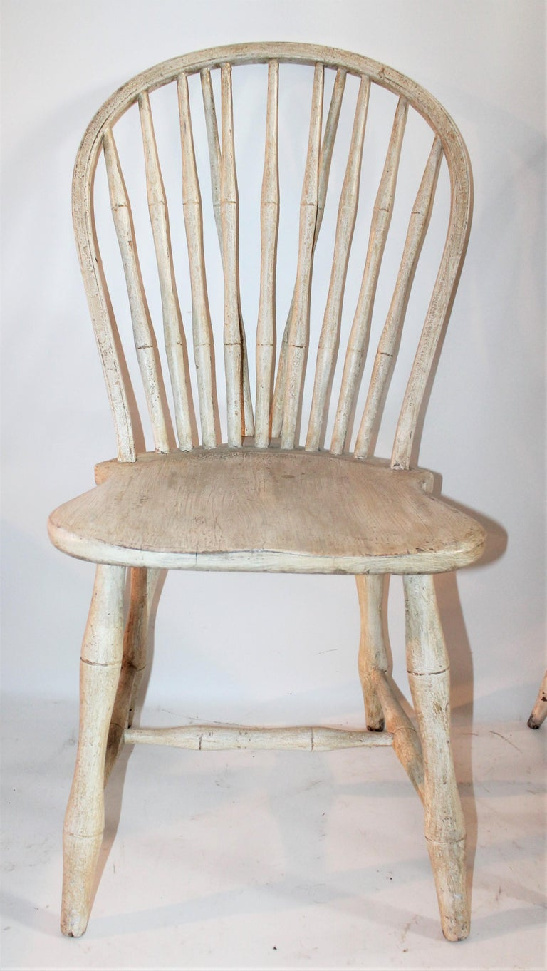 19th century original painted pair of accumulated Windsor chairs in old surface. This is two different chairs put together.