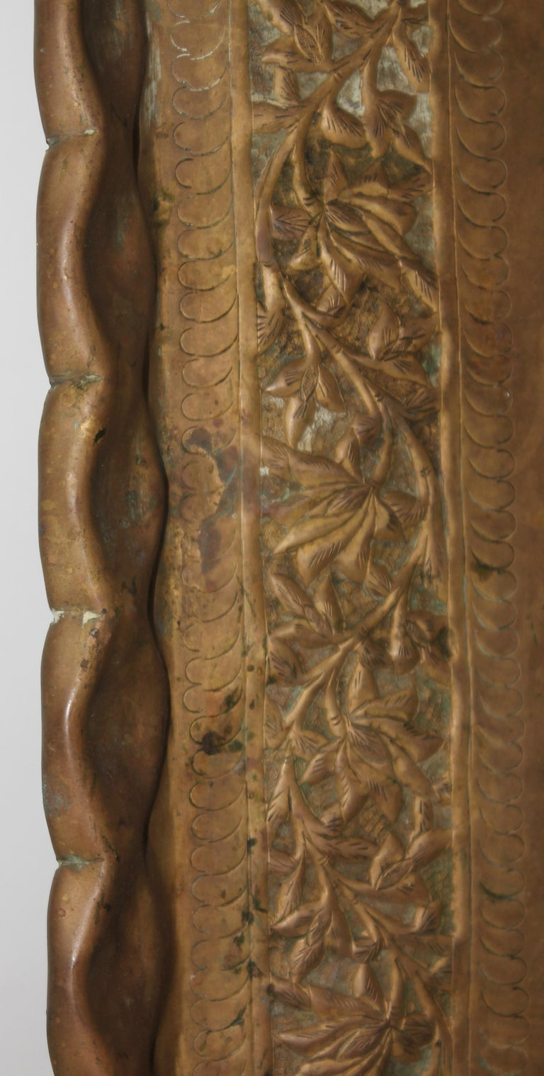 19Thc Original patinaed brass tray with wall hangers for hanging up or putting on a ottoman. It has a amazing age patina surface. The condition is very good.