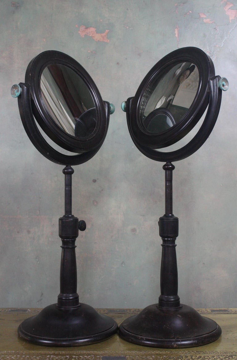 A large pair of scientific optical mirrors, one concave the other convex. 