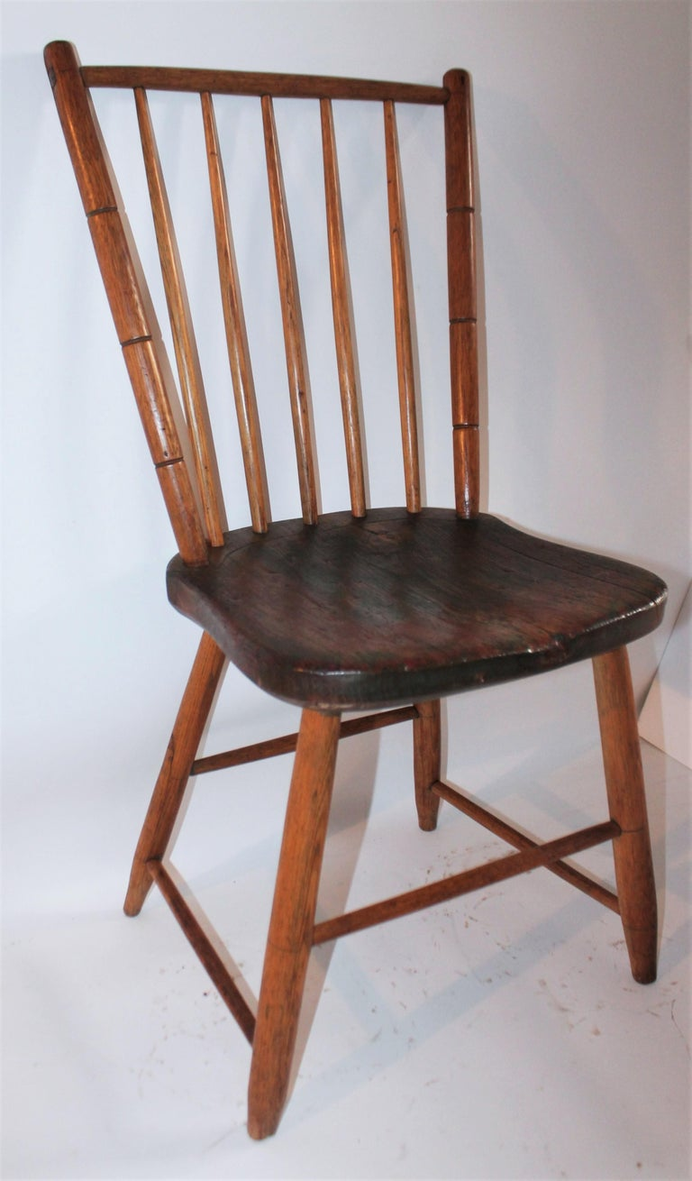 19th century Windsor with original green paint in grain. Great patina and great craftsmanship. Pennsylvania Bird Cage Windsor.