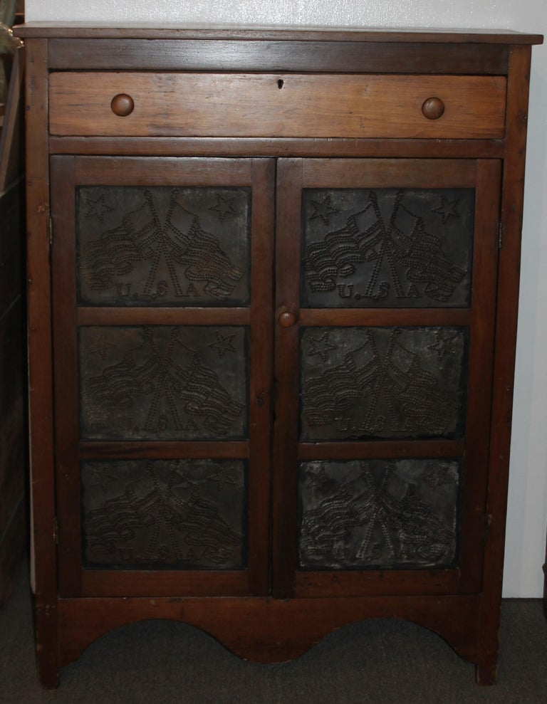 19thc punched tins cross flags pie safe all original and a natural old surface. This safe was found in East Tennessee and is in fine condition. The condition is very good and it is in working order. At one time this was probably painted and is in a