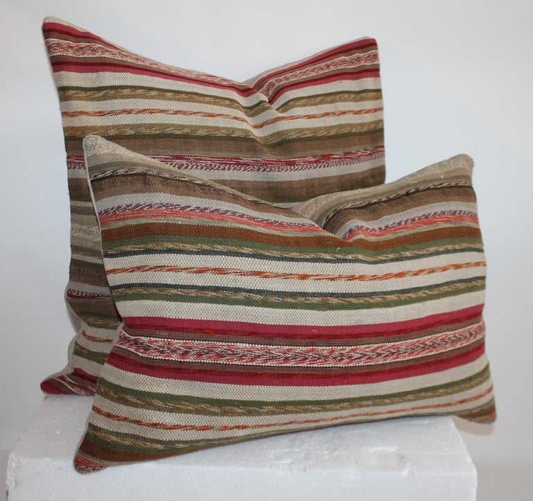 These country colors 19th century rag rug pillows are in fantastic condition. Sold as a pair of different sizes.  Larger pillow measures 24 x 22   Smaller pillow measures 24 x 16.
