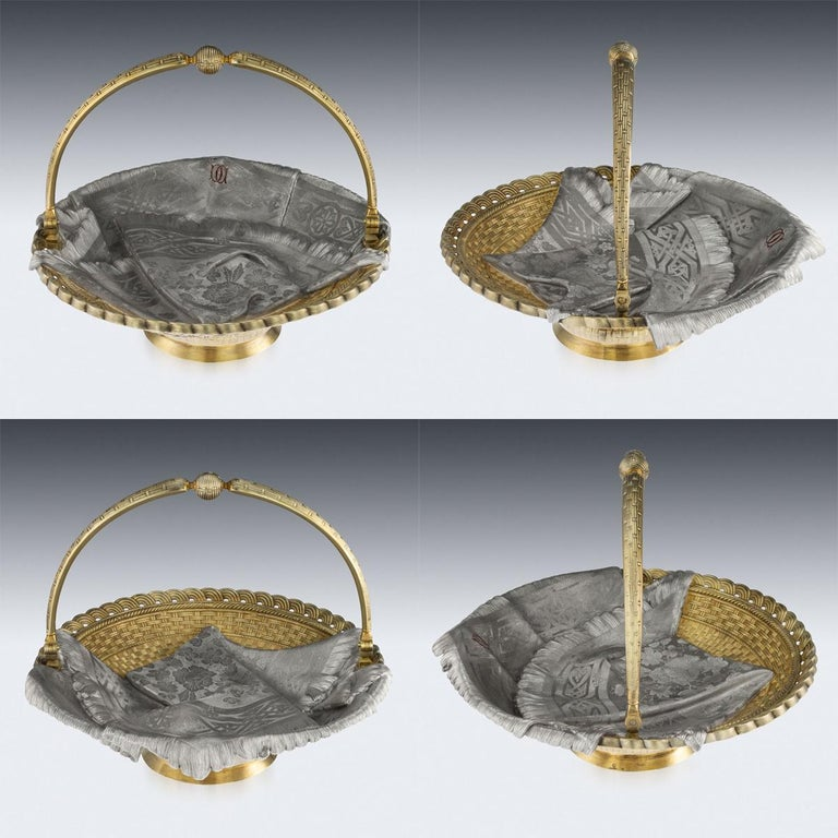 Antique 19th century Russian solid silver trompe l'oeil pair of bread baskets, large and of heavy gauge, of oval and round form, both embellished with a fringed cloth on woven ground, the smaller flanked by a pair of ropetwist handles and raised on