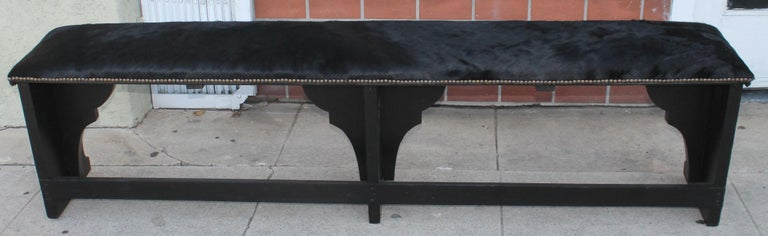 Late 19th Century  Pair of 19th Century Rustic Black Painted Cowhide Benches For Sale