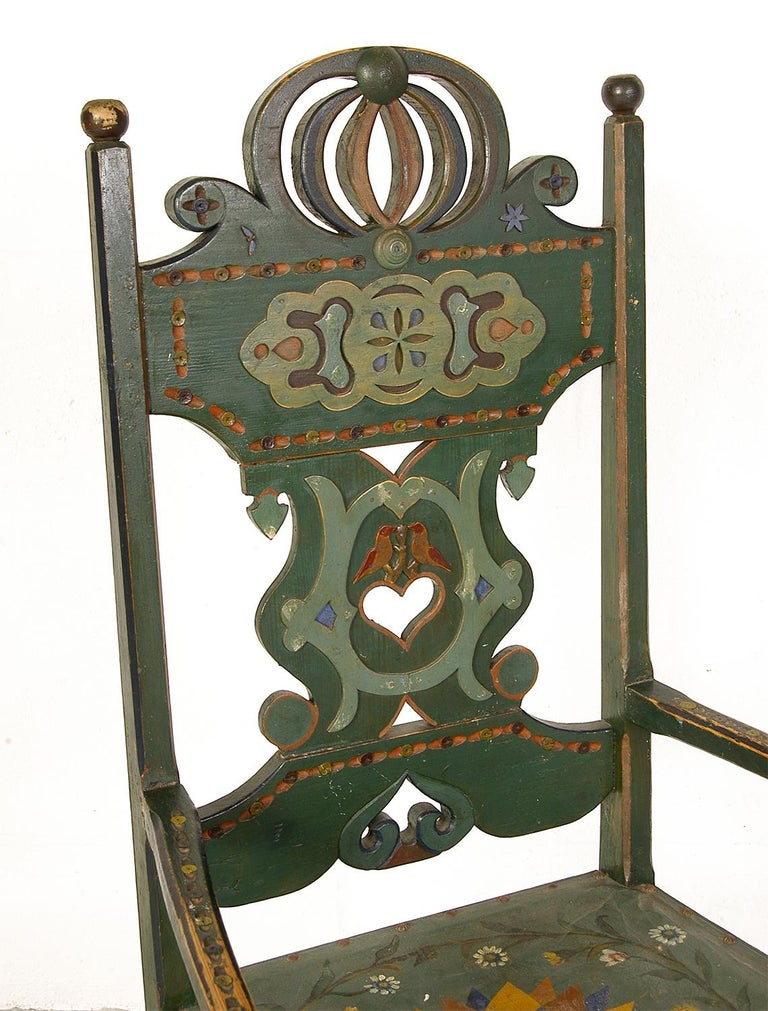 Still wearing its original, and beautifully worn multicolored polychrome paint, this rare Swedish chair epitomises the Folk Art style that blossomed in Sweden during the 18th and 19th century. This particular example has been well worn, and has