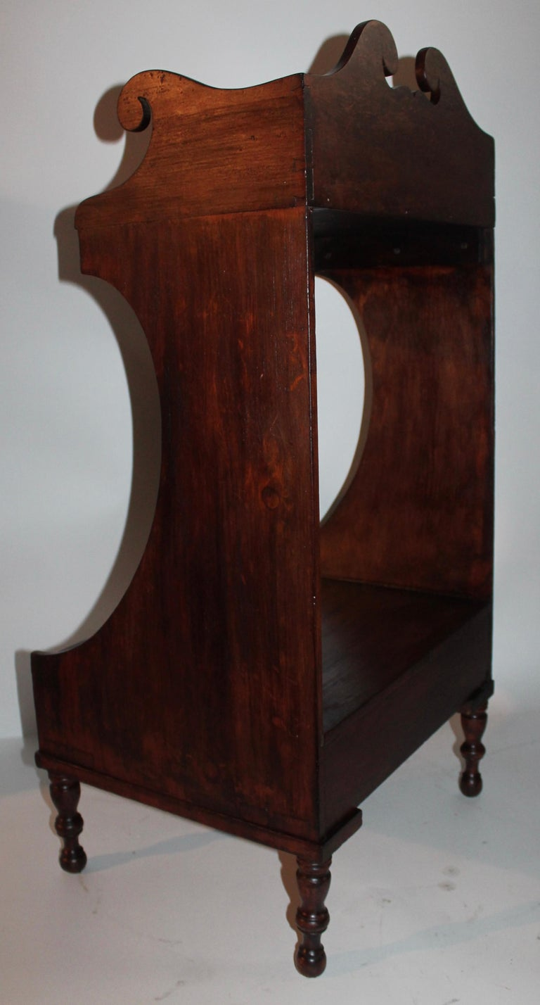19th century side table with dovetailed case and lower casing as well. It retains a old stained surface and all original hardware. The cutout are amazing and quite unusual. The condition is very good and sturdy. Makes a great side table or
