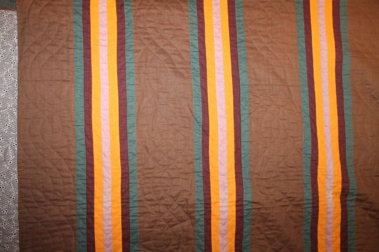 This fine split bars quilt was made in Lancaster County, Pennsylvania and is from the third quarter of the 19th century. It is quite rare the colors on a chocolate brown ground. It is in very good condition. These quilts were typically made in that