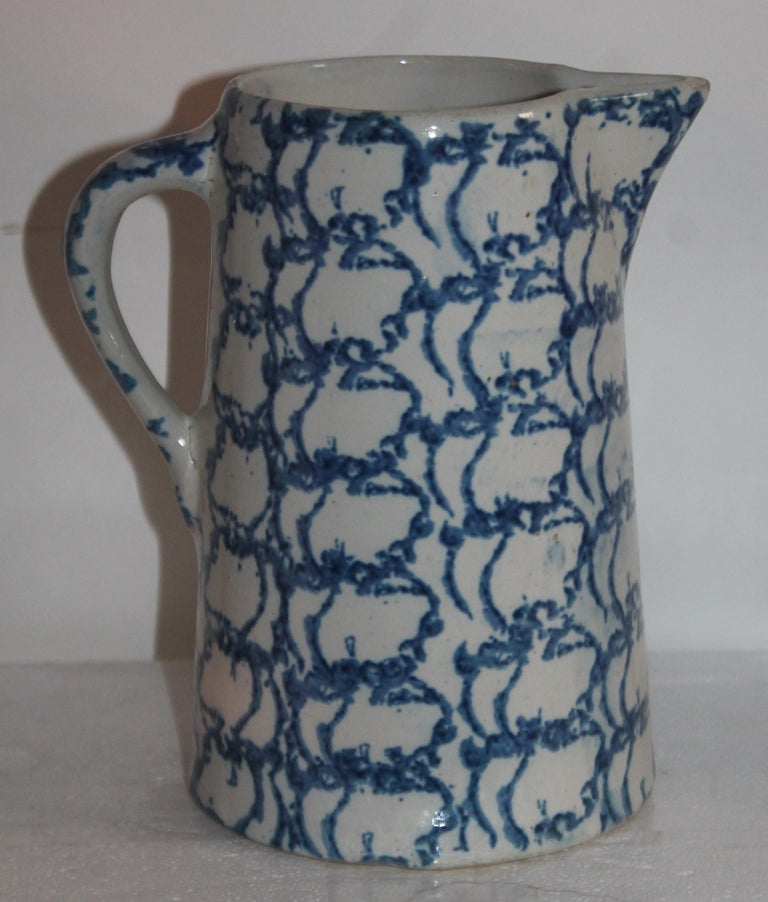 19th century sponge ware pottery pitcher in a design sponge pattern has a small chip on the inside lip. Rings like a bell with no cracks.