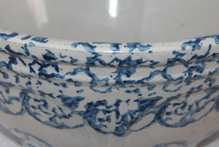 This large design sponge pottery bowl is in fine as found condition. It is a very large and most unusual size.