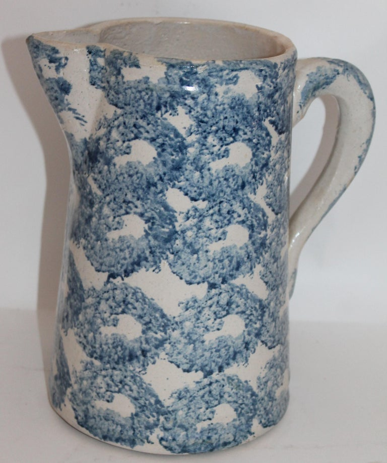 This fine 19th century sponge ware pottery pitcher is in fine condition and has the smoke ring pattern. Great shade of blue and great weight. Great for flowers on a table.