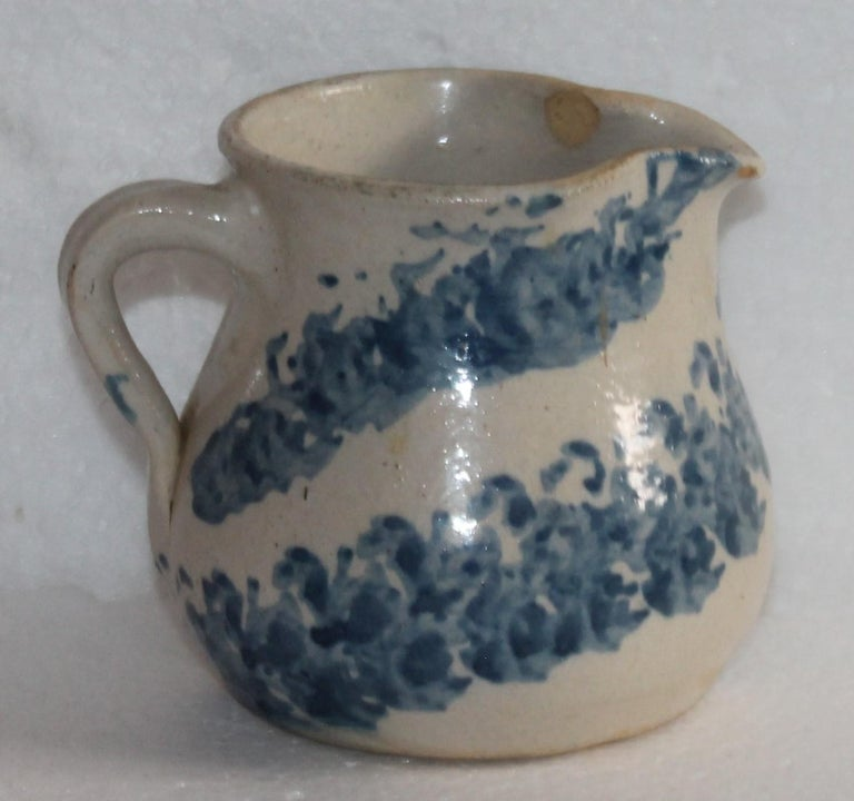 19th century rare form sponge ware milk pitcher in pottery. This is a handmade piece. The condition is very good with a minor small chip on the inner lip inside the pitcher near the spout. Very minor and not noticed from the outside.