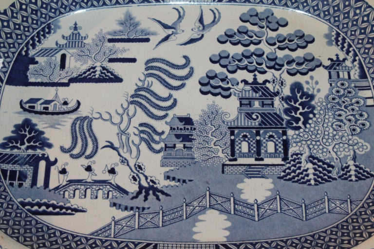 This 19th century large blue willow serving platter is signed Staffordshire, England. The condition is in mint condition.
