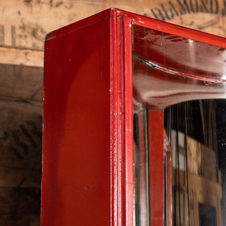 Antique late 19th century Victorian pair of concave fairground mirrors. This pair of mirrors set in a wooden box frame that has been painted a vibrant postbox red. A real conversation piece and a superb piece of history reminiscent of the gone by