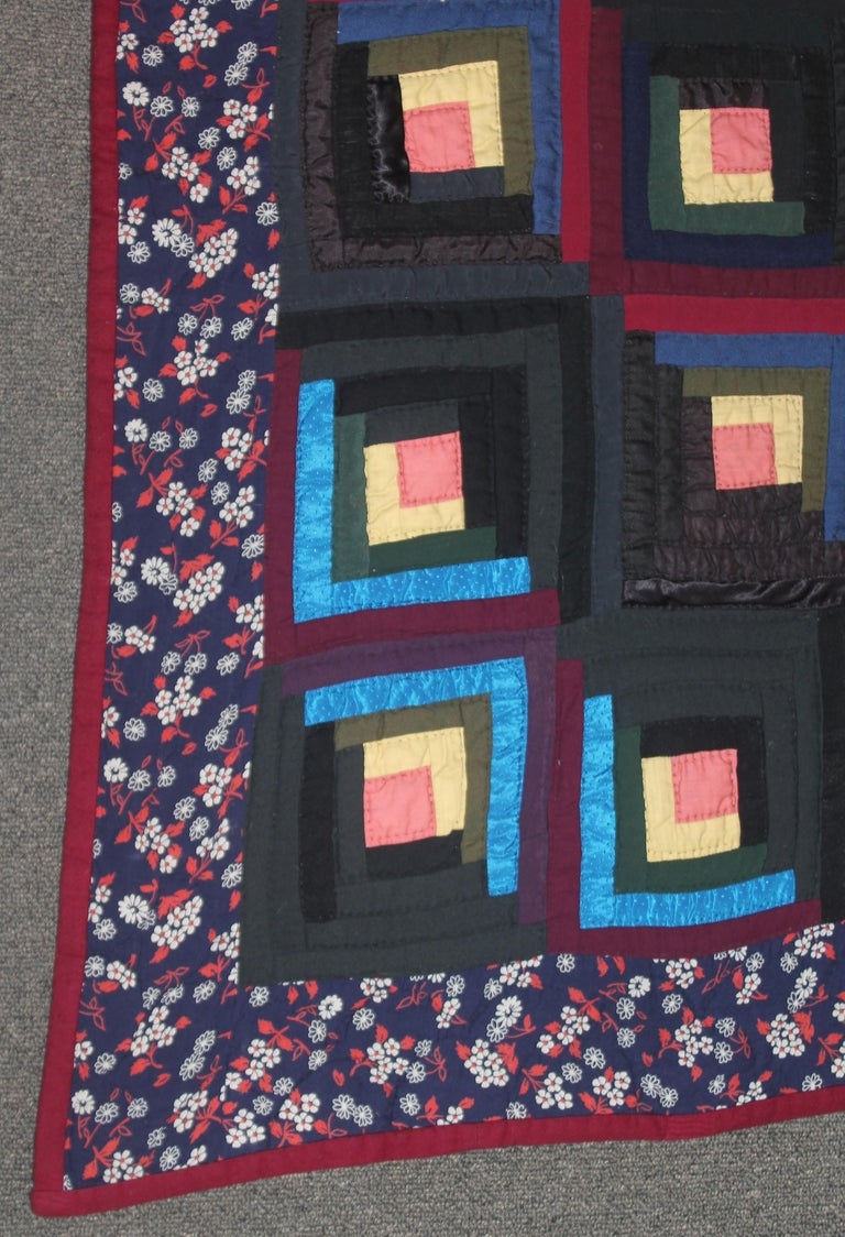 19thc wool & satin log cabin barn raising quilt and has a wool flannel backing. This quilt is in pristine condition.