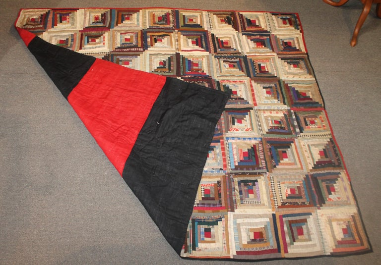 19th century wool log cabin quilt in good condition. This was found in central Pennsylvania. It has a red and black wool bars backing.